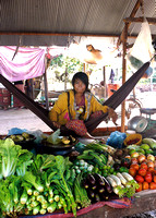 Young woman selling produce at village market near Siem Reap
